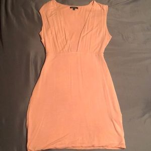 Mini light pink dress with open chest